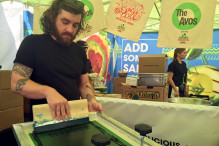 Screen printing the tote bags at SXSW; Image via Culture Collide
