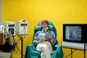 A woman attached to an EEG machine. (Image via Newsweek)