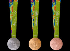 This year's Olympic medals feature sustainable materials and features for impaired athletes. (Image via Rio 2016)