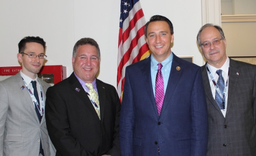 Left to Right: Kyle A. Richardson; Bruce Korn, CAS, president of Zakback Inc.; Congressman Ryan Costello (R-PA); Larry Whitney, director of global compliance for Polyconcept North America.
