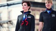 American Airlines executives are wearing the company's new uniforms to try to prove they aren't harmful. (Image via USA Today)