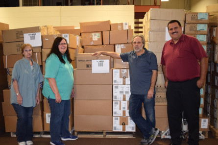 Edwards Garment team members donated 15 skids of apparel to the Salvation Army