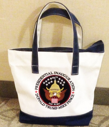 Attendees at the Inauguration Ball received an assortment of Trump-themed products in this tote bag. (Image via Us Weekly)