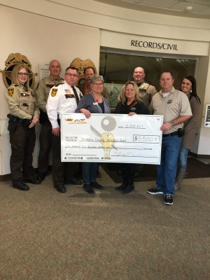 Cassie Otto, Deb Fleming and Linda Huppert of BIC Graphic Red Wing visited the Goodhue County Sheriff Department to present them with the donation on Feb. 2.