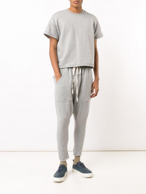 GQ predicts it's all about the untucked, shorter tee. (Image via Farfetch)