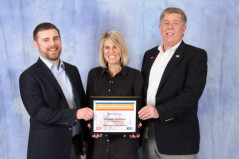 HanesBrands employees James Francis, Maria Teza and Mike Jeske accept the company's eighth consecutive and tenth overall United Way of North Carolina Spirit Award.